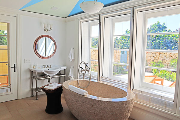Main floor bathroom in guest house Ananda at Santosha Villa Estate on Long Bay