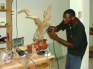 Anguilla sculputre - Cheddie working