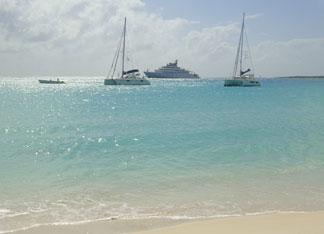 sailboats visiting cove bay