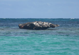 famous rock in savannah bay junk's hole