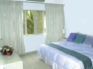 Ku Hotel Bedroom