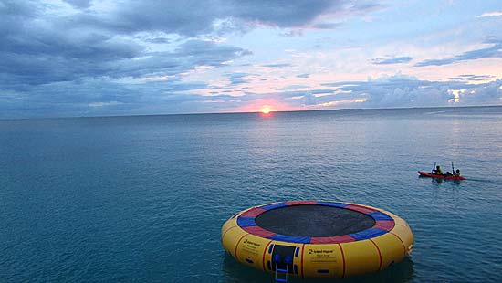 kayak and trampoline pelican trail sunset