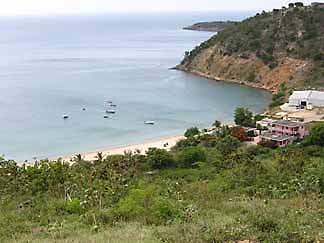 Few real estate opportunities on Crocus Bay, but many more in the hills surrounding it.
