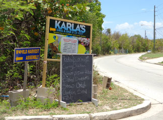 Anguilla restaurant, Karla's At De Reef, road sign