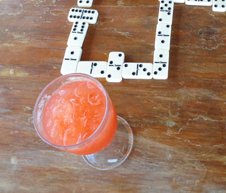 rum punch while playing dominoes on sandy ground