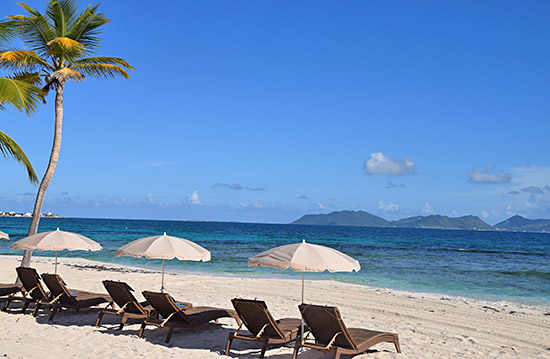 beach chaises on beach at the reef anguilla
