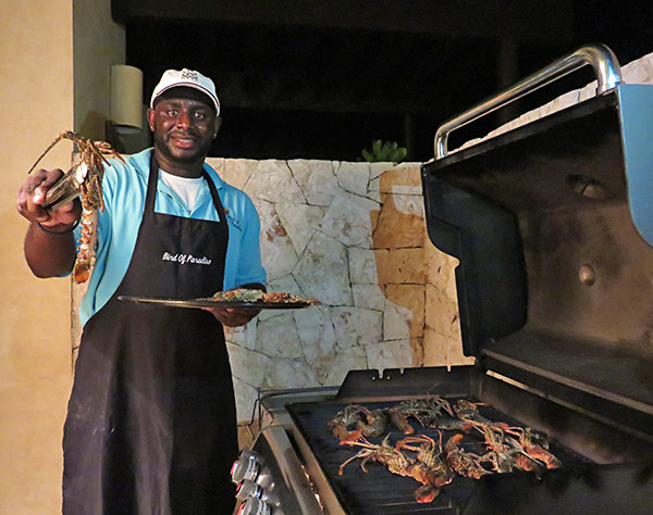 chef kylon grilling crayfish at bird of paradise villa