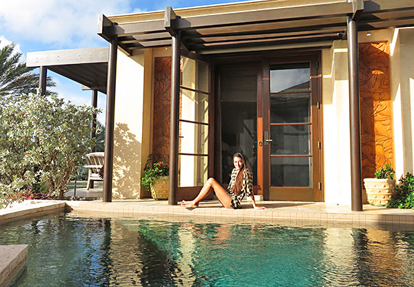 lazing by the pool at bird of paradise villa