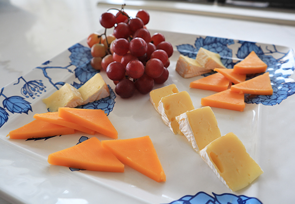 Brie and cheddar cheese with grapes at Champagne Shores