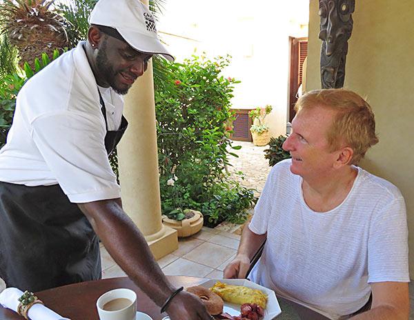 chef kylon serving breakfast at bird of paradise villa