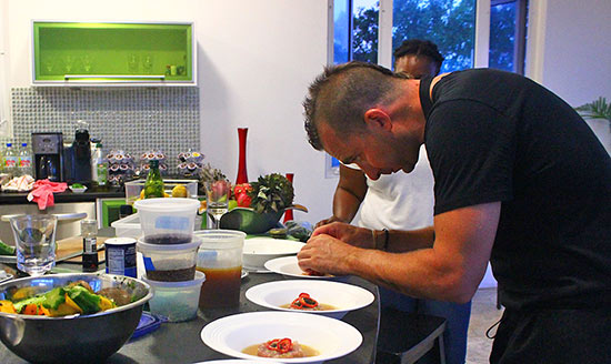 chef marc forgione putting the finishing touches on tartare
