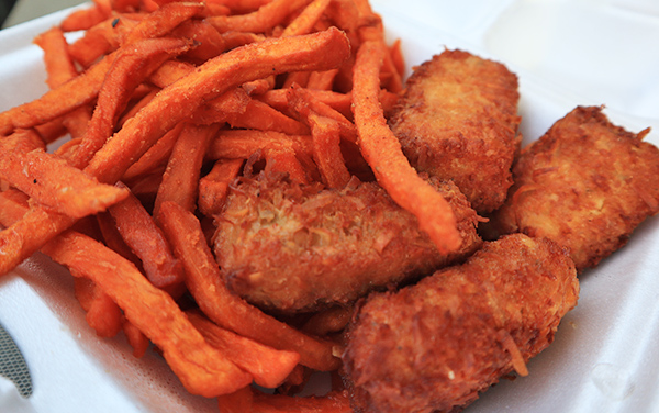 Crispy coconut mahi mahi strips and sweet potato fries