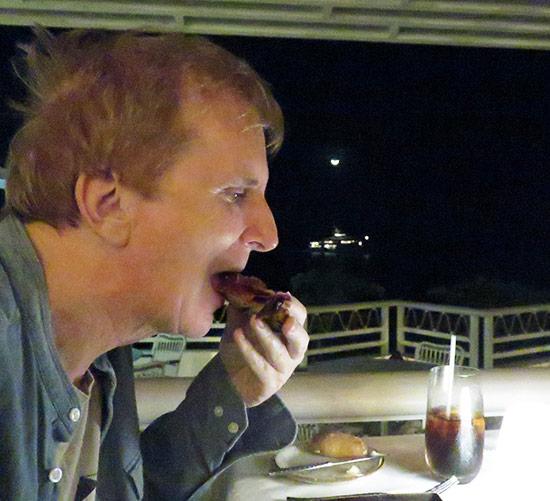 dad biting into iberico ham