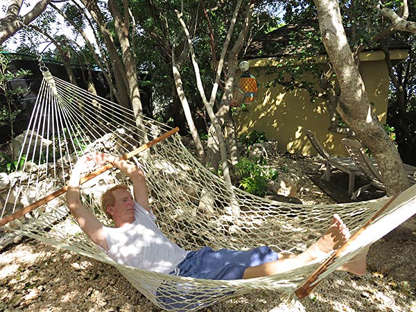 dad lounging in the luxury villa's hammock
