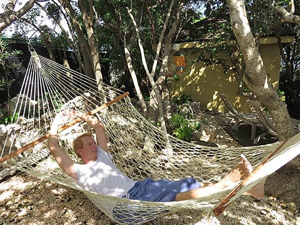 dad lounging in the luxury villa's hammock
