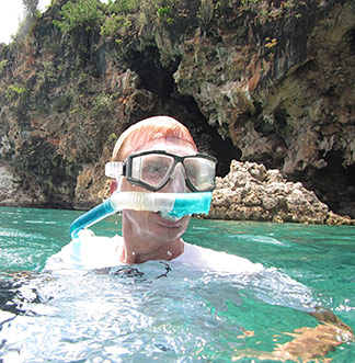 dad with snorkel mask in little bay