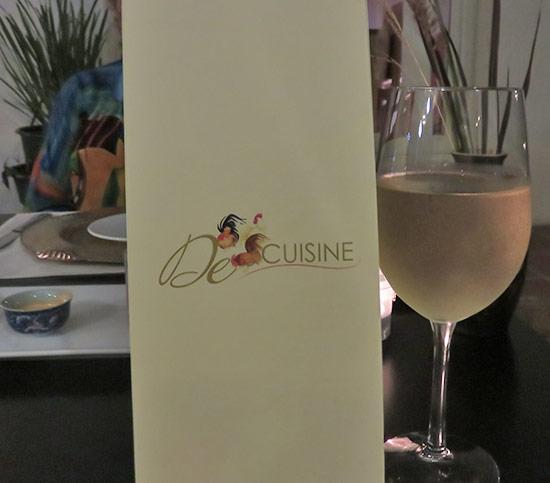 menu and a glass of wine at de cuisine