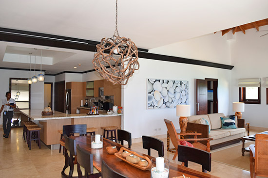 kitchen living and dining in the beachfront suite