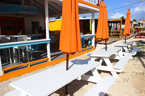 exterior dining space at sharpys including umbrellas and picnic tables