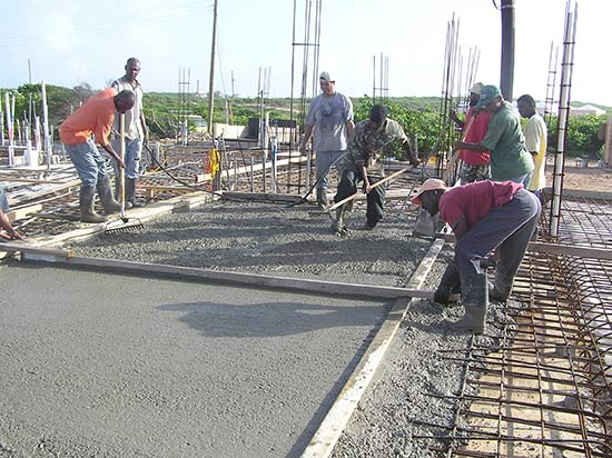 The First Team Places And Vibrates The Concrete