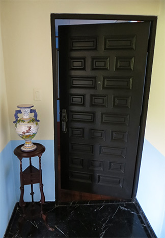door to bedroom inside gloria vanderbilt suite