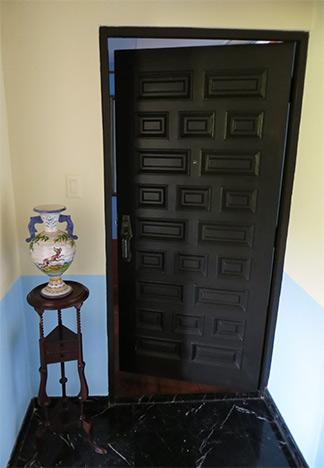 door to bedroom inside gloria vanderbilt suite
