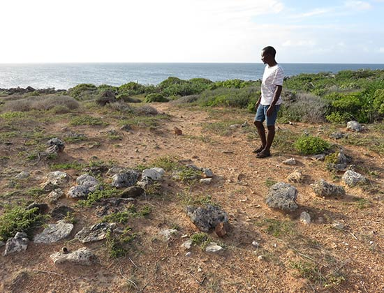 john explaining amerindian site in anguilla
