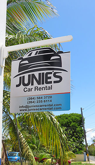 junies car rental sign