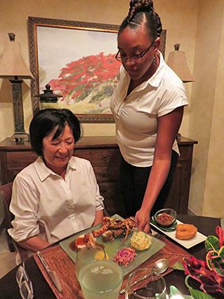 kaira serving dinner at bird of paradise villa