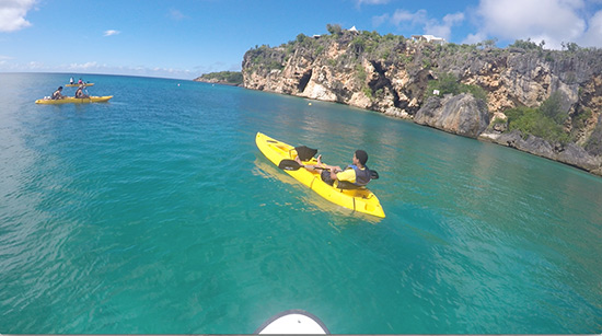 heading out of little bay towards its cliffsides