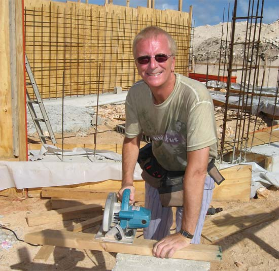 Anguilla builder Ken sawing