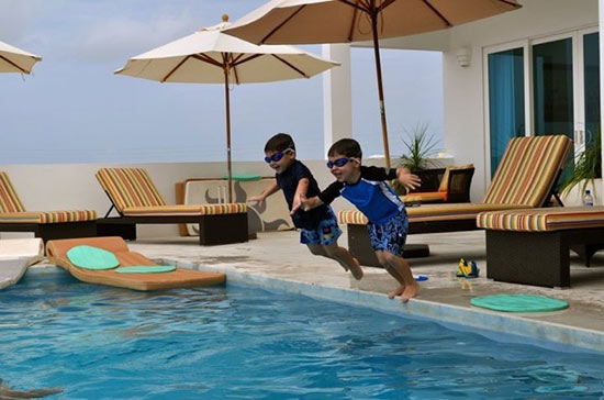 jumping into the pool at tequila sunrise villa