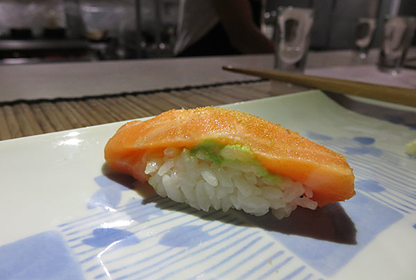 lightly seared salmon sushi with charcoal salt in anguilla