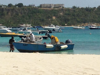 fishermen returning with lionfish catch in anguilla