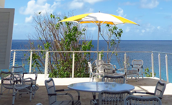 the outside terrace that joins off from the bar at malliouhana