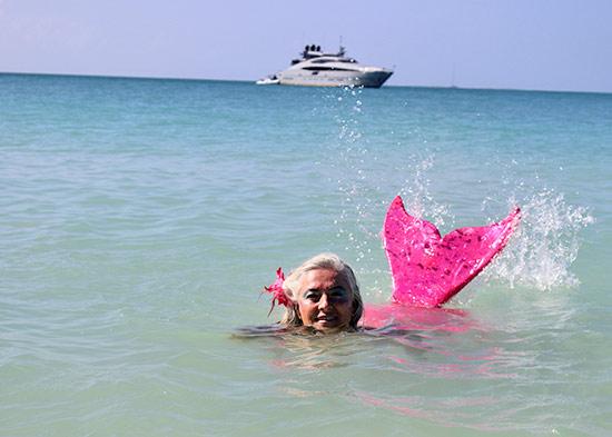 splashing the sea with mermaid tail