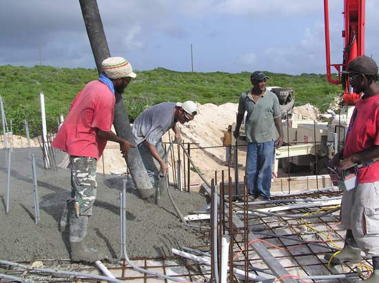 Mike Vibrating Concrete Into The Block Holes