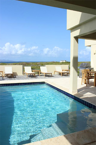 outdoor living space with pool at moondance villa
