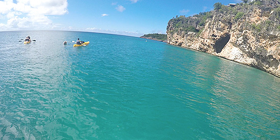 the towering cliffs that surround little bay anguilla