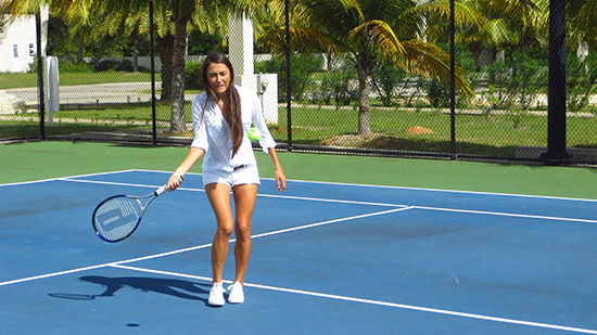 practicing front hand at anguilla tennis academy
