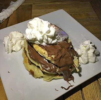 Nutella pancakes and whipped cream from waves