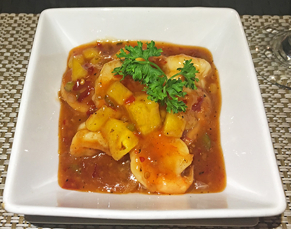 mouth watering pineapple rum glazed shrimp at flavors restaurant