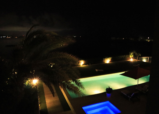 Pool lights at night with view of Saint Martin