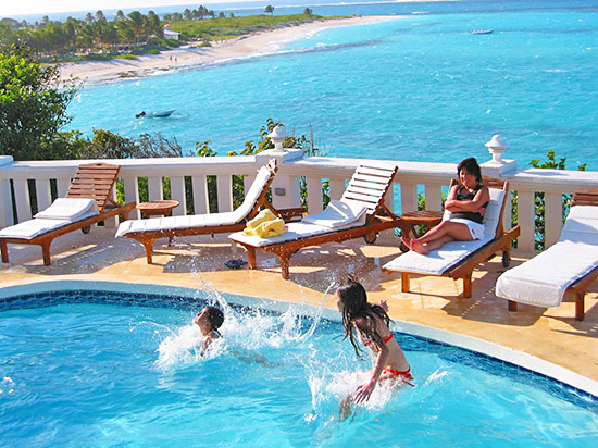 jumping into tortue villa pool in anguilla overlooking shoal bay