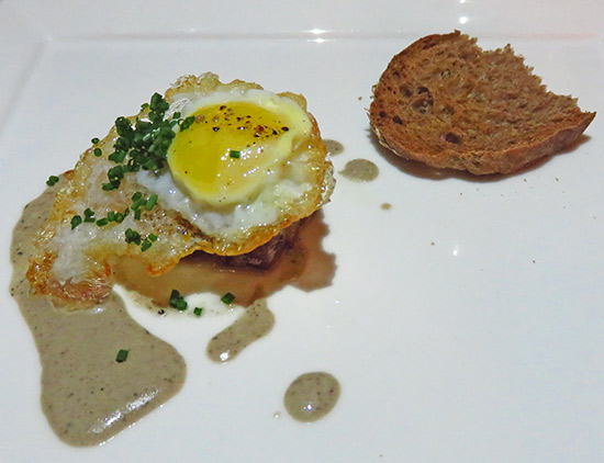 quail egg with edwards farm bacon and country bread