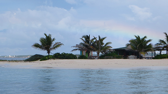 rainbow over sandy island