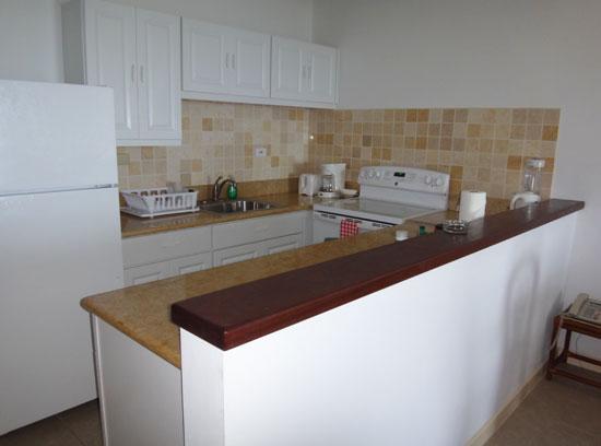 full kitchen at shoal bay villas