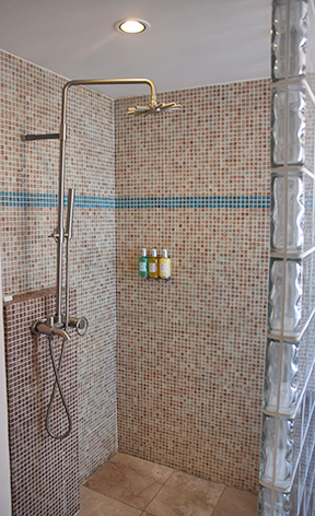 mosaic tiled shower at frangipani