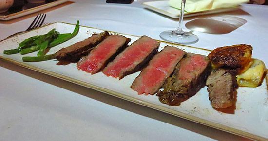 signature cut of tomahawk steak plated at malliouhana