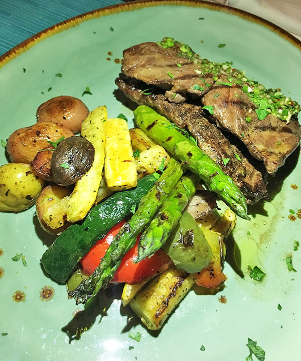 Steak and potatoes at four seasons bamboo bar and grill